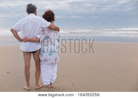 A Man And A Retired Senior Woman On The Relaxing Beach