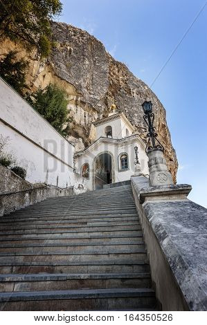 Bakhchisaray Crimea Russia . Holy - Assumption Orthodox cave Monastery .The monastery bell tower in front of the Church of the Dormition .