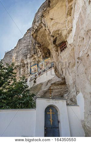 Entrance to the Church of the Assumption . Above the temple on the rock icon of the Mother of God .