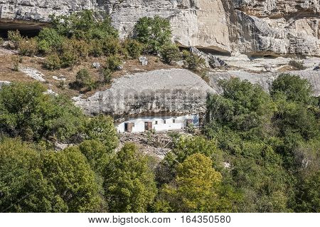 Bakhchisaray Crimea Russia . Holy - Assumption Orthodox cave Monastery.Carved into the rock premises economic purposes .