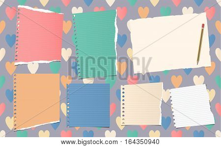 Ripped ruled notebook, copybook, note paper strips with pencil stuck on pattern created of colorful heart shapes.