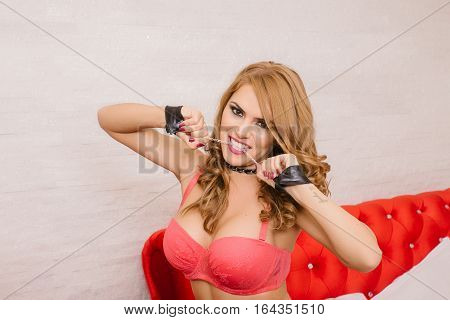 Portrait of a beautiful sexy woman wearing handcuffs