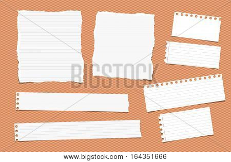 Pieces of ripped different size white note, notebook, copybook paper sheets, strips stuck on squared orange background.
