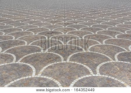 Texture of road surface made grey pave stones with oriental ornament