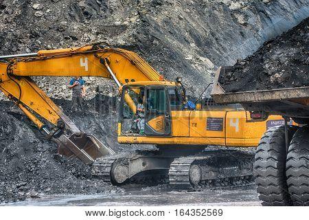 NOVOKUZNETSK, RUSSIA - JULY 26, 2016 Big orange excavator at worksite