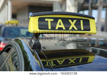 Sign of a german Taxi in a Row