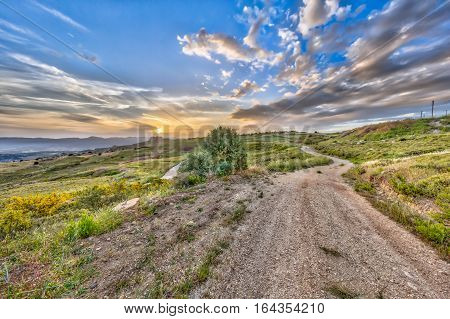 Road Through Mediterranean Landscape On The Island Of Cyprus