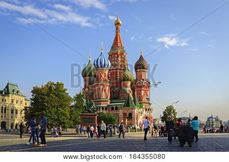 MOSCOW / RUSSIA - SEPTEMBER 22, 2015: The Cathedral of Vasily the Blessed on the Red Square is a very popular tourist destination in the capital