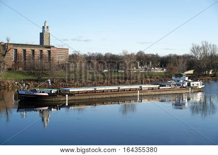 MAGDEBURG, GERMANY - DECEMBER 29, 2016: Ship traffic on the Elbe near Magdeburg. On the banks of the river Elbe stands the lookout tower in the city park