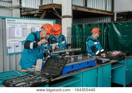 Tobolsk, Russia - July 15. 2016: Sibur company. Polymer plant. Technicians carry out adjusting in the workshop