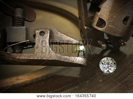 Faceting diamond big gem with jewelery cutting equipment.