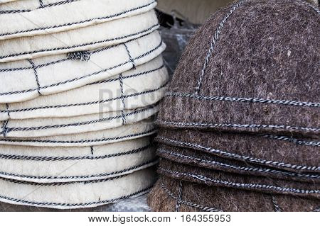 Bunch of handmade colorful ethnic styled woolen hats on the traditional fair