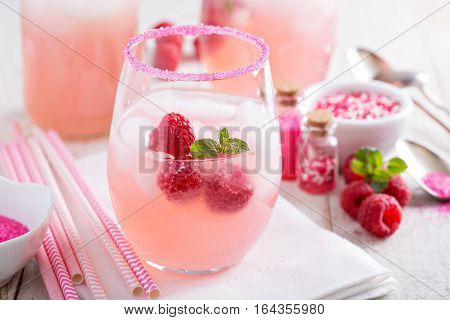 Red raspberry lemonade or cocktail in glasses with sugared rim