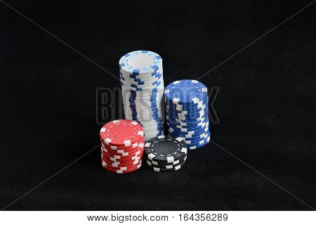 image of gambling chips on a black background