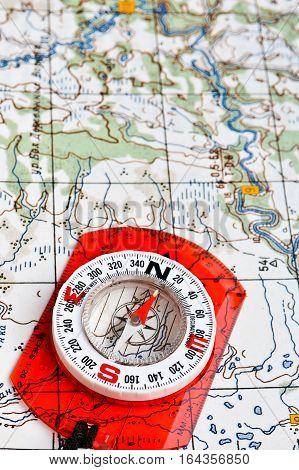 Map with compass. Necessary navigational tools they will not get lost.