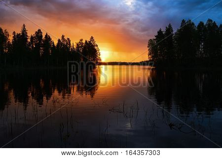 Finnish landscape at sunset with Lake sky and trees