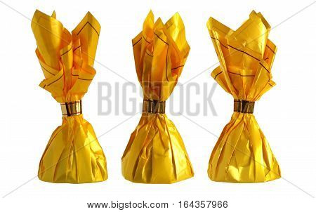 Yellow candy wrappers isolated on white background