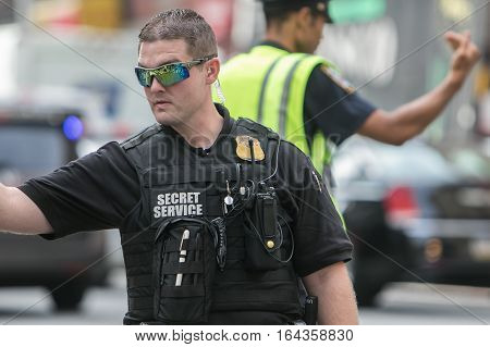New York, September 20, 2016: A Secret Service agent is helping direct traffic and keeping the reserved lane on the 2nd Avenue clear during the UN General Assembly.