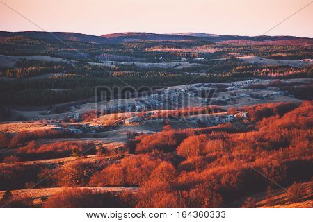 Aerial Sunset view of Mountains plateau area with forest natural sunset red colors Travel scenery