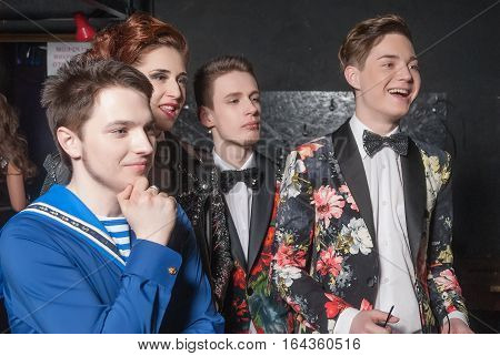Tyumen, Russia - April 16, 2014: Competition of young performers the Song knows no limit in dramatic theater. Participants of a competition watch the performer on the stage