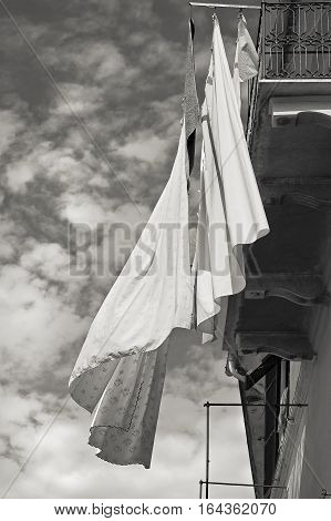 sheets hung out the window with cloud monochrome