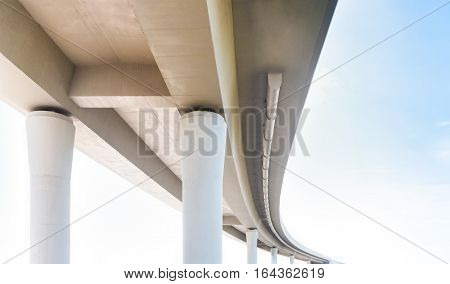 Concrete overpass view from below on the sky background