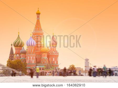 Blured people on Red Square in Moscow with Saint Basil's Cathedral on the background