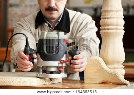 Man doing woodwork in carpentry. Professional woodworker