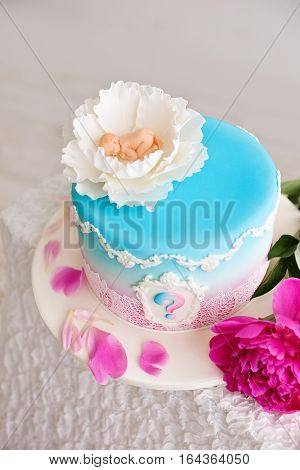 baby shower cake pink and blue flowers with a peony