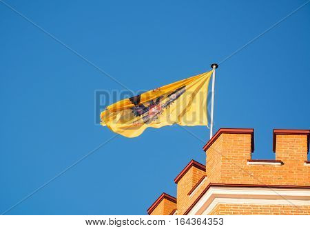 The flag with the double-headed Russian eagle flying in the fortress tower