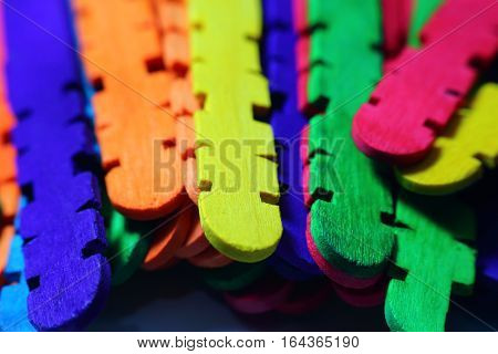 Multicolored interlocking wood playing rods. Entertainment for children.