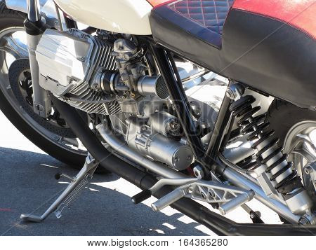 Motorcycle chromed engine closeup detail. Side view