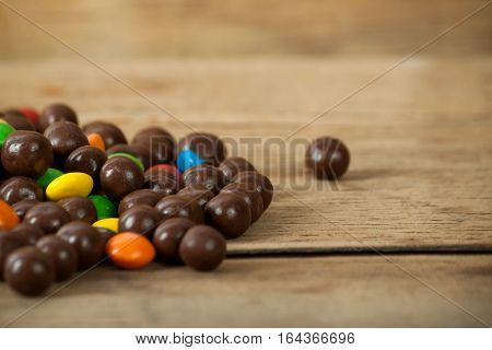 Multi color candy close up on wood desk. Sweet