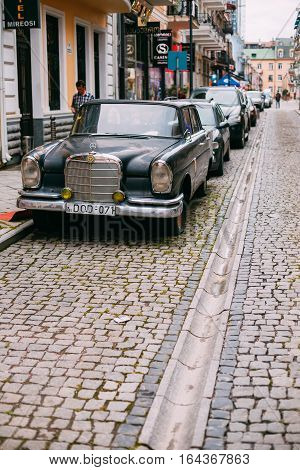 Batumi, Georgia - May 28, 2016: Batumi Georgia. The Black Rarity Retro Mercedes Benz Car At The Parking In A Row Along Narrow Paved Street In Summer Daytime.