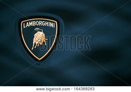 Tallinn, Estonia - December 2, 2016: Close Logo Of Lamborghini. Automobili Lamborghini S.p.A. is an Italian brand and manufacturer of luxury sports cars and SUVs based in Sant'Agata Bolognese, Italy