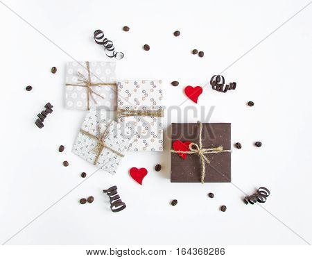 Rustic Handmade Gift Boxes On White Background Decorated With Hearts And Paper Serpentine. Top View,