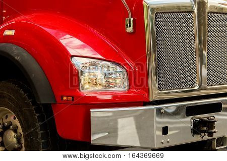 Front end of a semi truck while parked red truck