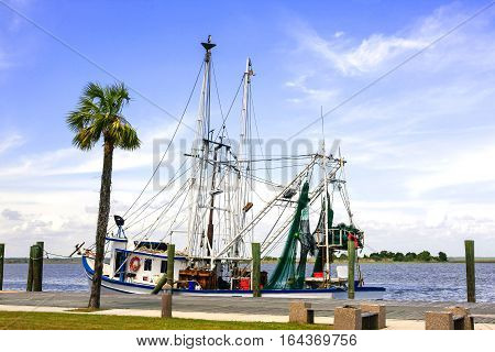 Apalachicola, FL, USA - April 11: Fishing boat tied up along the Apalachicola Estuary in Florida leading to the Gulf of Mexico