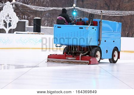 special machine ice harvester cleans the ice rink