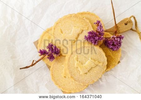 Shortbread biscuits on the white surface with lavender flowers