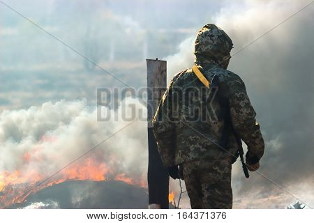 Military soldiers at tactical exercises near fire