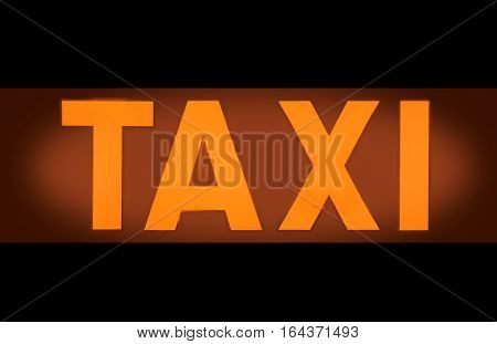 Detail Of An Orange Taxi Light Sign