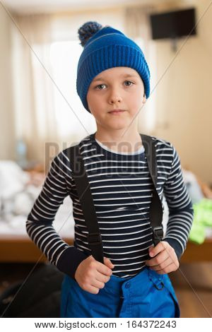 Child Dressing For Skiing.