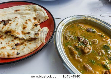 Delicious Chicken Tikka Masala with chapati. Indian cousine.