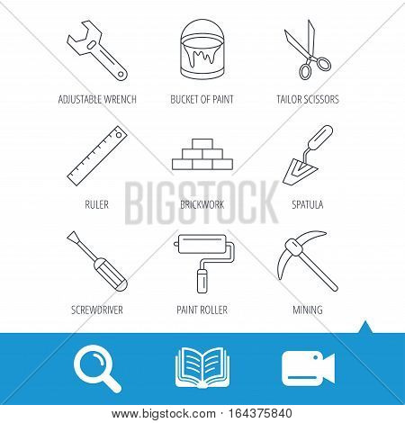 Screwdriver, scissors and adjustable wrench icons. Spatula, mining tool and paint roller linear signs. Brickwork, ruler and painting icons. Video cam, book and magnifier search icons. Vector