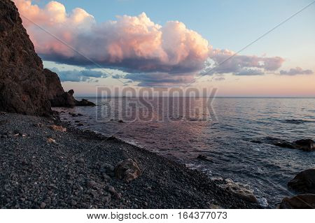 Lanscape of Watercolor Sunset sky under the rocket seaside