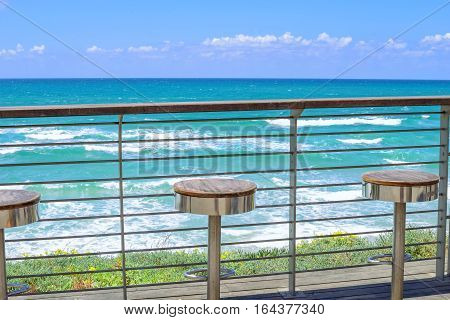 Empty seats on the seafront observation deck with seaside view
