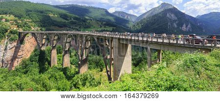 TARA RIVER CANYON MONTENEGRO - AUGUST 10 2014: Panoramic view of the bridge of Dzhurdzhevich over the Tara River Canyon