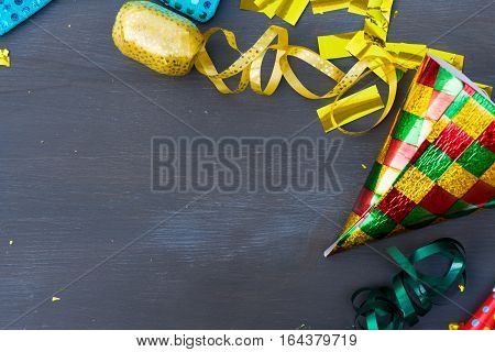 Carnaval festive decorations with copy space on dark wood