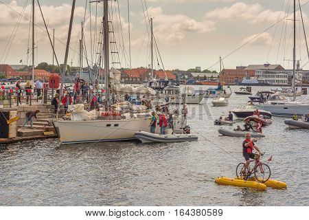 Copenhagen, Denmark, July 15, 2016 - People greeting the popular danish sailingboat Havana after circumnavigation. A pontoon bike in the foreground.
